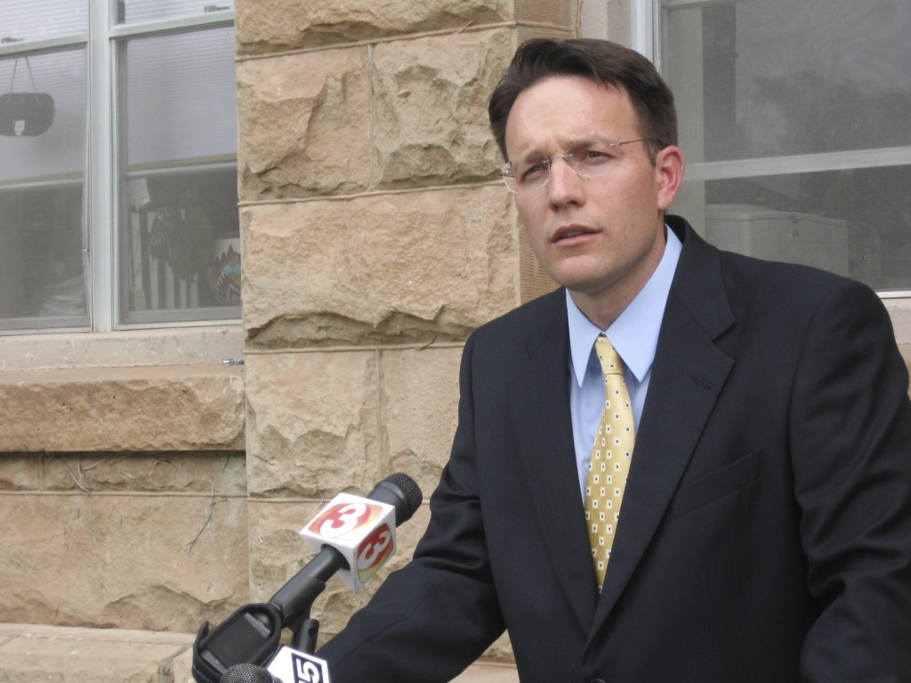 FILE - In this June 16, 2009, file photo, Apache County Attorney Michael Whiting speaks outside the courthouse in St. Johns, Ariz., to reporters about...