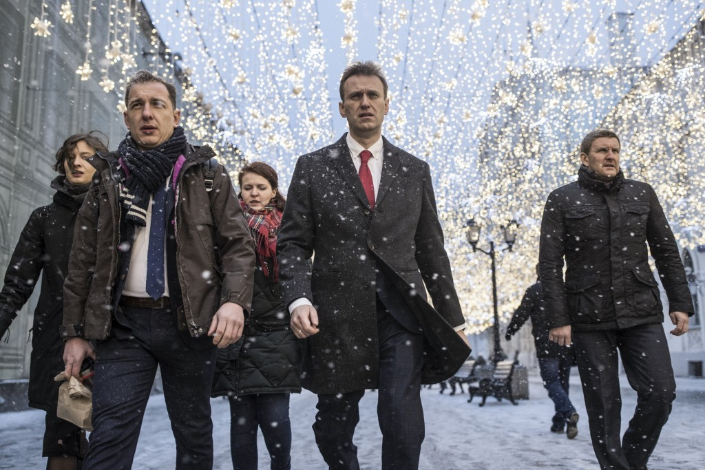 Russian opposition leader Alexei Navalny, who submitted endorsement papers necessary for his registration as a presidential candidate, center, heads t...