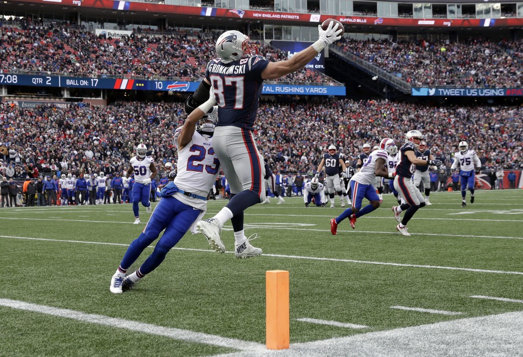 New England Patriots tight end Rob Gronkowski (87) makes a one-handed catch of a Tom Brady pass, as Buffalo Bills safety Micah Hyde (23) defends, befo...