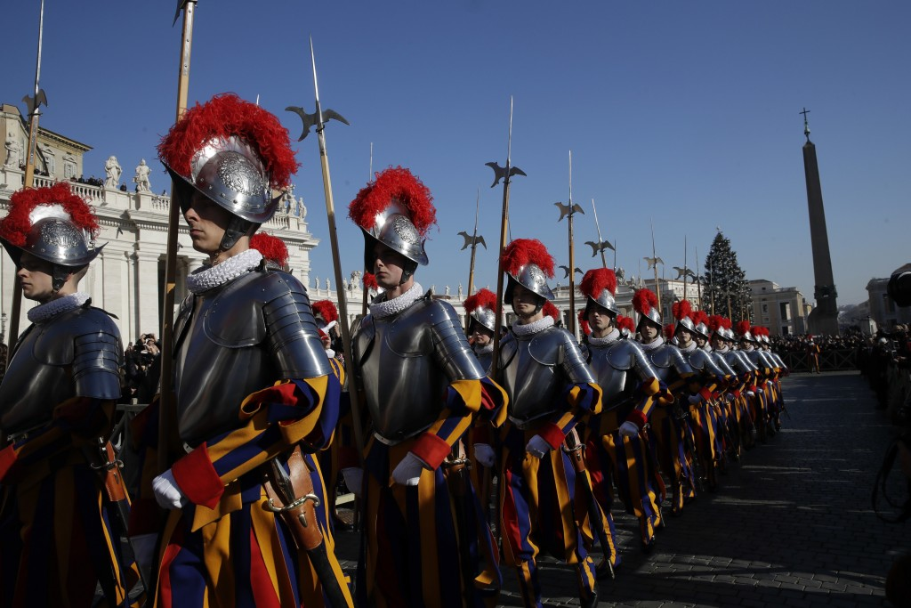 Vatican Swiss guards march toward the St. Peter's Basilica prior to the start of Pope Francis' Urbi et Orbi (Latin for 'to the city and to the world')...