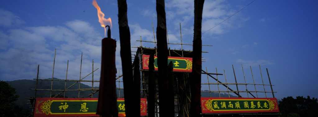 In this Dec. 10, 2017, photo, lit incense sticks are seen in front of a shed during the Tai Ping Ching Jiu festival at Lam Tsuen village in Hong Kong....