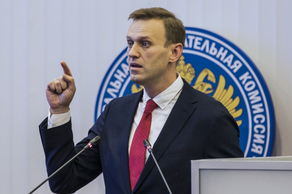 Russian opposition leader Alexei Navalny, who submitted endorsement papers necessary for his registration as a presidential candidate, gestures while ...