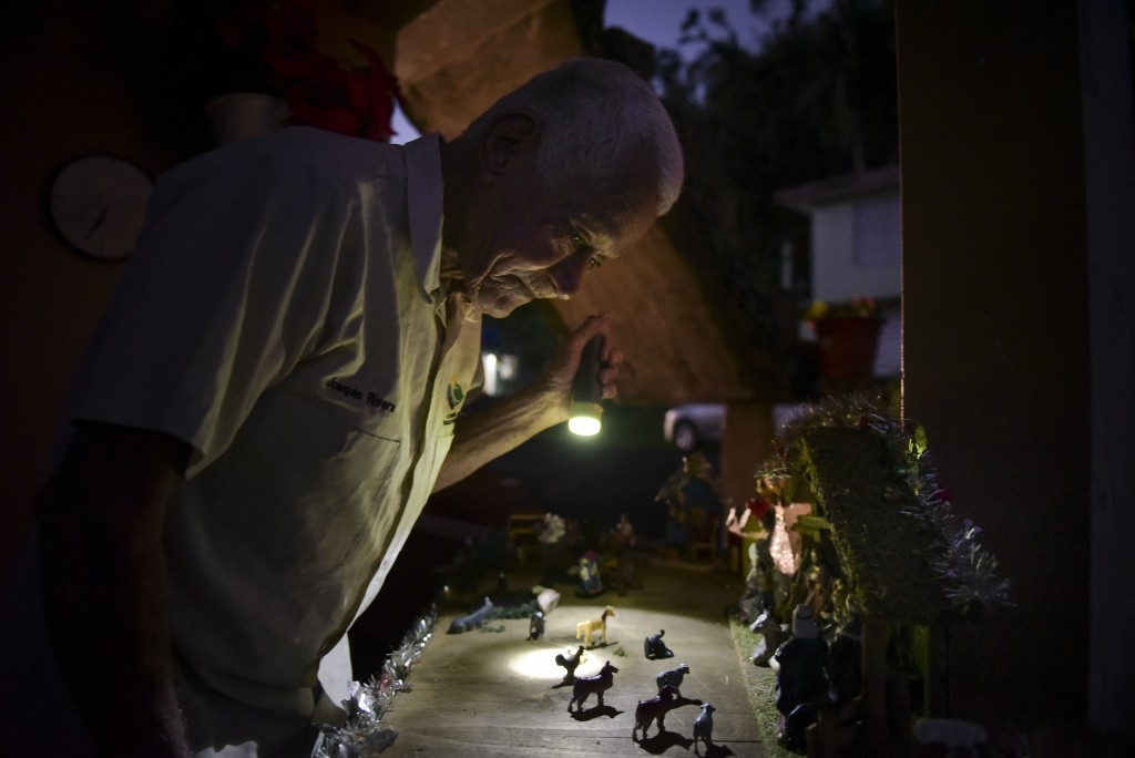In this Dec. 22, 2017 photo, 75 year old Joaquin Rivera Calderon gets up early to check out a model allusive to the birth of the baby Jesus establishe...