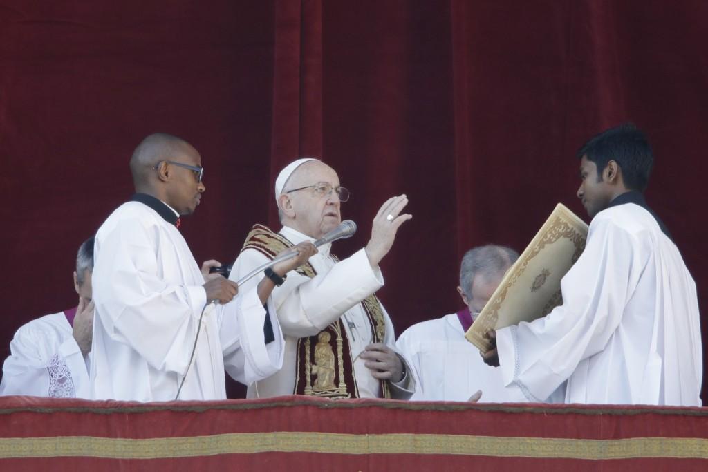 Pope Francis delivers the Urbi et Orbi (Latin for ' to the city and to the world' ) Christmas' day blessing from the main balcony of St. Peter's Basil...