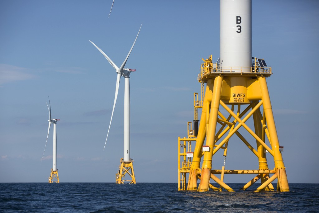 FILE - In this Monday, Aug. 15, 2016, file photo three wind turbines from the Deepwater Wind project stand in the Atlantic Ocean off Block Island, R.I...