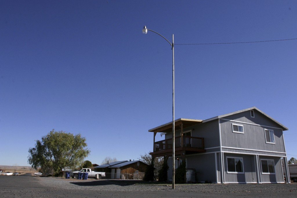 FILE - This Nov. 8, 2008, file photo shows the house in St. Johns, Ariz., where Vincent Romero and Timothy Romans, of San Carlos, Ariz., were found fa...