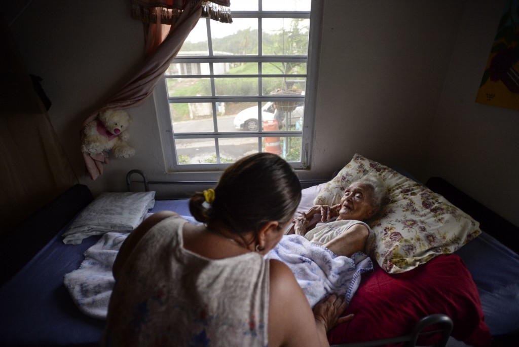 In this Dec. 21, 2017 photo, 96 years old Rosa Maria Torres stays bedridden in her residence at the San Lorenzo sector, which is partially cut off whe...
