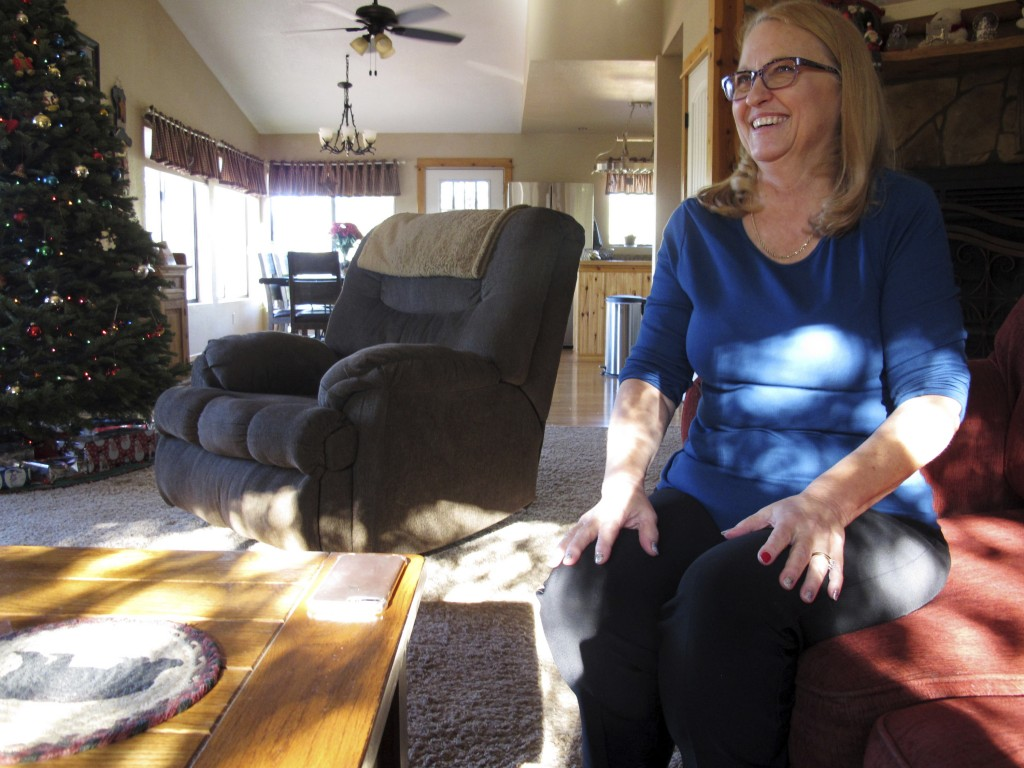 In this Friday, Dec. 15, 2017 photo, Debbie Neckel sits in her home. Neckel was the lead detective in a 2008 case in St. Johns, Arizona, where an 8-ye...