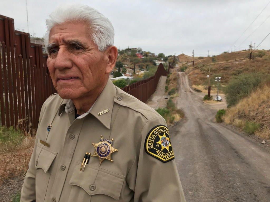 In this Dec. 5, 2017, photo, Santa Cruz County Sheriff Tony Estrada poses for a photo in Nogales, Ariz., on the U.S. side of the international boundar...