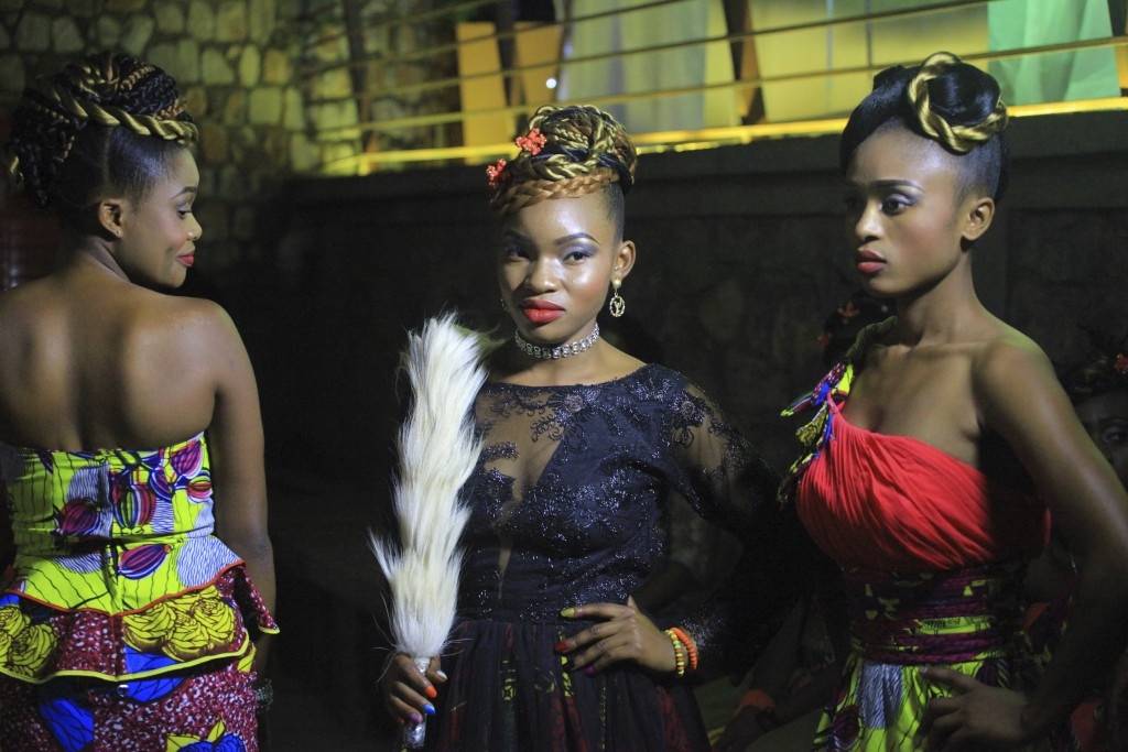 In this photo taken Saturday Dec. 23, 2017, Models pose for a photograph back stage before a fashion show in Beni Eastern Congo . Young Congolese desi