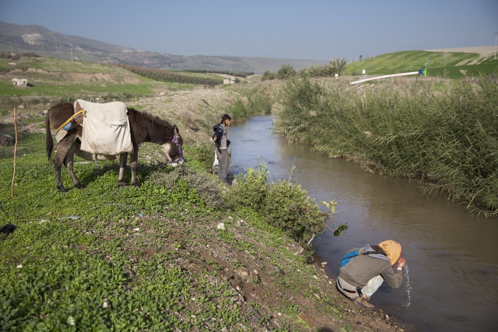 In this Tuesday, Jan. 17, 2017 photo, Israelis tour along the Jordan River near the Israeli village of Menahemia. Israel is heading into its fifth con...