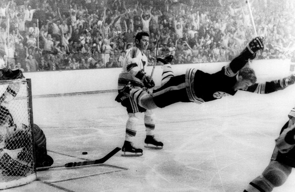 FILE - In this May 10, 1970, file photo, Boston Bruins' Bobby Orr goes into the air after scoring a goal against the St. Louis Blues that won the Stan...