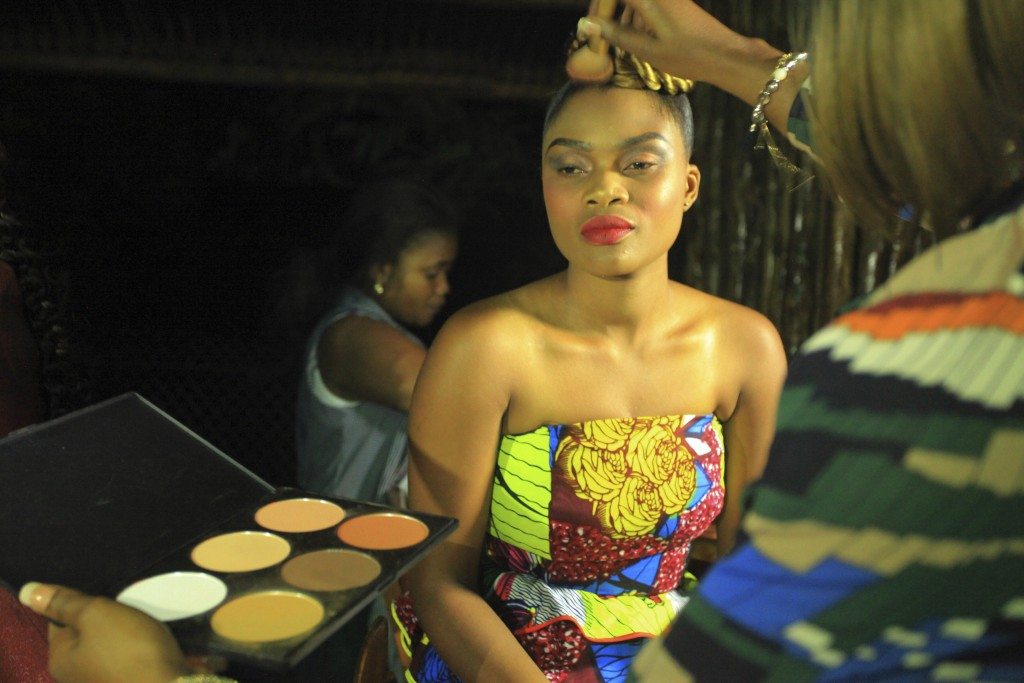 In this photo taken Saturday Dec. 23, 2017, A model makeup back stage before a fashion show in Beni Eastern Congo . Young Congolese designer Miki Sika