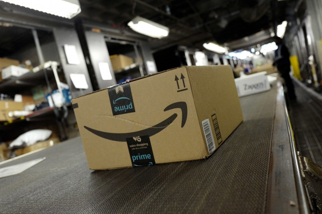In this Tuesday, May 9, 2017, photo, a package from Amazon Prime moves on a conveyor belt at a UPS facility in New York. Online shoppers will pay clos...