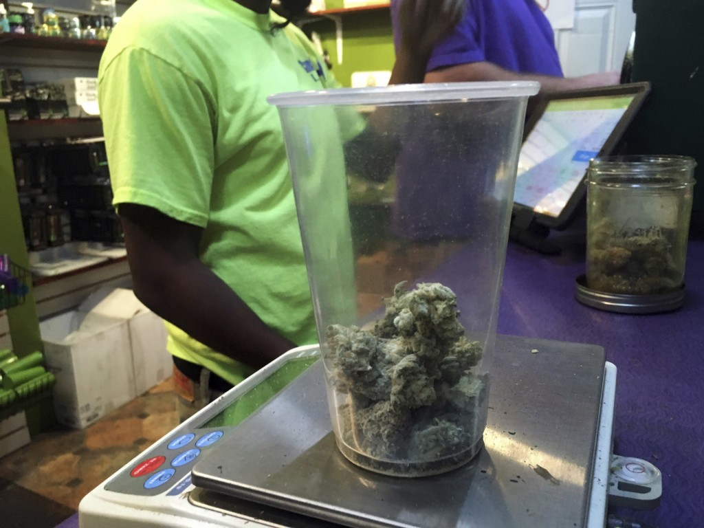 This Tuesday, Oct. 3, 2017, photo shows marijuana at Canna Can Help Inc., a medical marijuana dispensary in Goshen, Calif. Labor unions are vying to r...