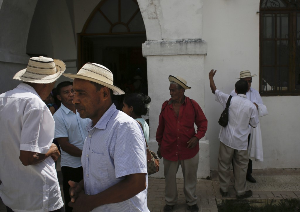 "In this Dec. 17, 2017 photo, men wearing traditional Panamanian pintao hats leave Sunday Mass in La Pintada, Panama. ""The pintao hat has become an int..."