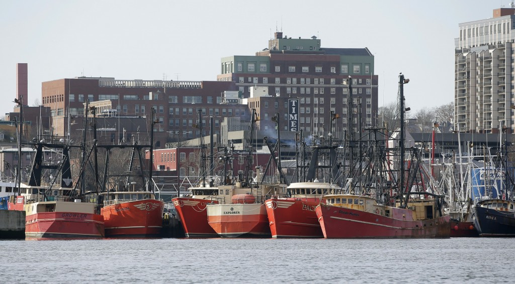 In this Wednesday, Dec. 6, 2017 photo fishing vessels are docked in New Bedford Harbor, in New Bedford, Mass. Fishermen in the nation's most lucrative...