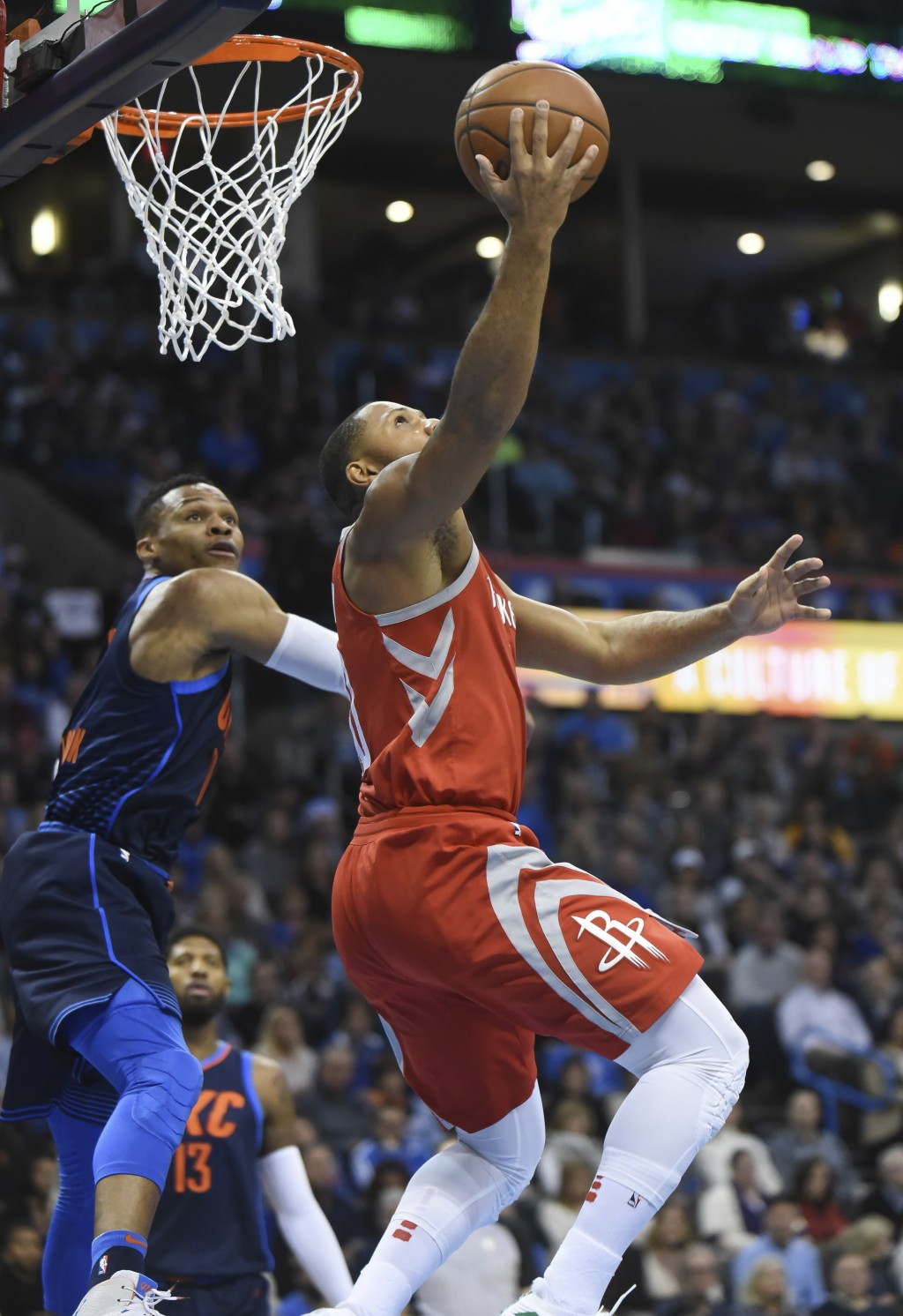 Houston Rockets' Eric Gordon, right, goes up for a shot over Oklahoma City Thunder's Russell Westbrook, left, in the first quarter of an NBA basketbal...