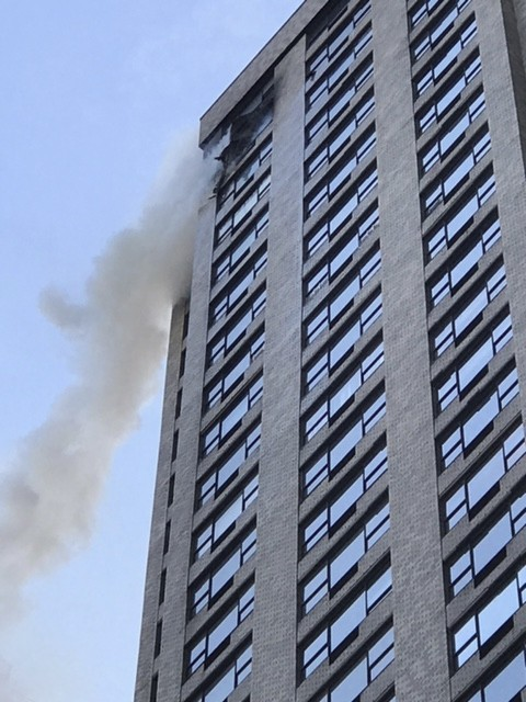 In this photo provided by WPIX-TV, smoke billows from the 35th floor of a Manhattan high rise building in which the The New York Police Department sai