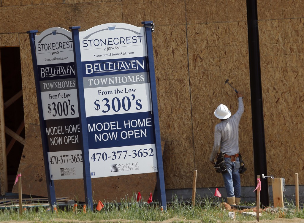 FILE - In this Tuesday, May 16, 2017, file photo, a construction worker continues work on new town homes under construction in Woodstock, Ga. The Stan...