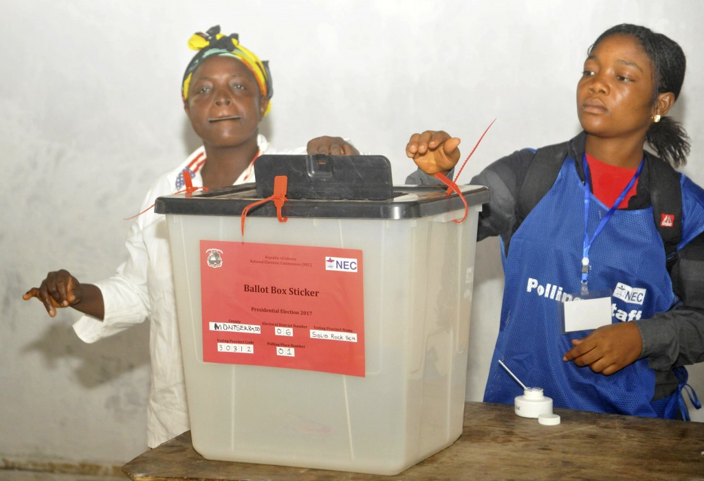 A woman cast her vote during a Presidential runoff election in Monrovia, Liberia, Tuesday, Dec. 26, 2017. Young Liberians went straight from all-night...
