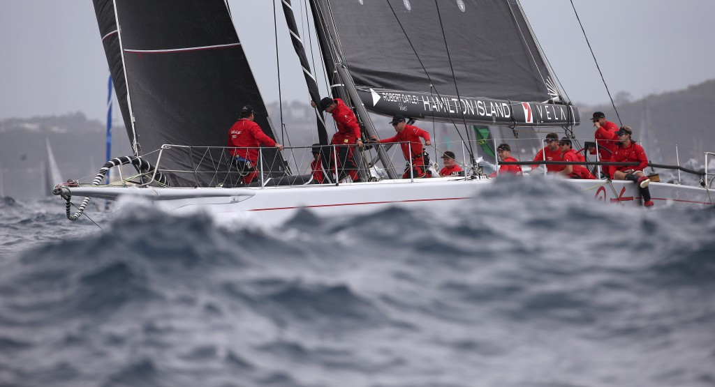 In this Dec. 26, 2017, file photo, Wild Oats X enters open water during the start of the Sydney Hobart yacht race in Sydney. The 630-nautical mile rac...