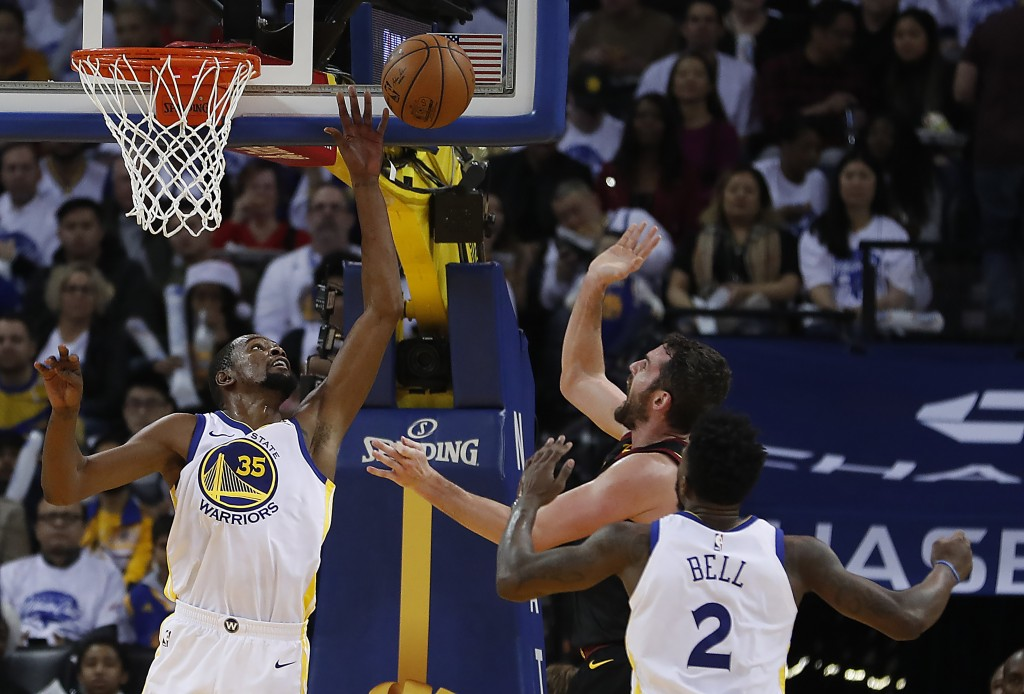 Golden State Warriors forward Kevin Durant (35) blocks a shot by Cleveland Cavaliers forward Kevin Love (0) during the second half of an NBA basketbal...