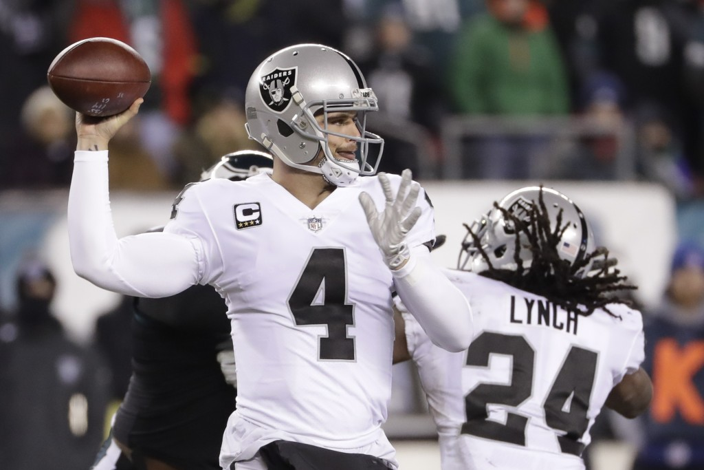 Oakland Raiders' Derek Carr passes during the first half of an NFL football game against the Philadelphia Eagles, Monday, Dec. 25, 2017, in Philadelph...
