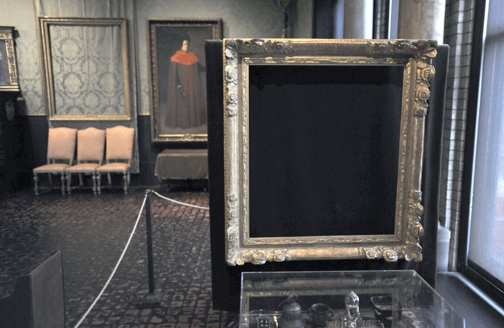 """FILE - In this March 11, 2010, file photo, empty frames from which thieves took """"Storm on the Sea of Galilee,"""" left rear, by Rembrandt and """"The Concer..."""