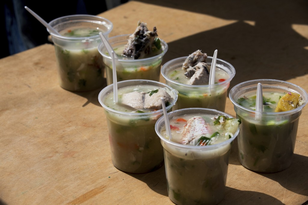 In this Dec. 9, 2017 photo, fish soup sits ready to serve to residents attending a free medical campaign sponsored by the opposition in La Guaira, Ven...