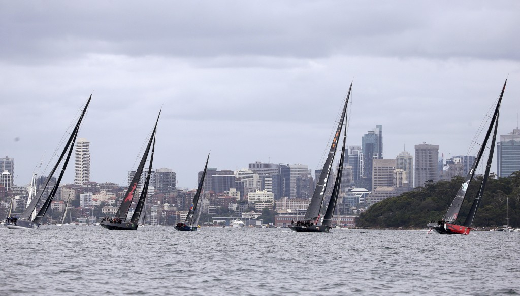 Some of the larger boats leave the start line during the Sydney Hobart yacht race Sydney, Tuesday, Dec. 26, 2017. The 630-nautical mile race has102 ya...