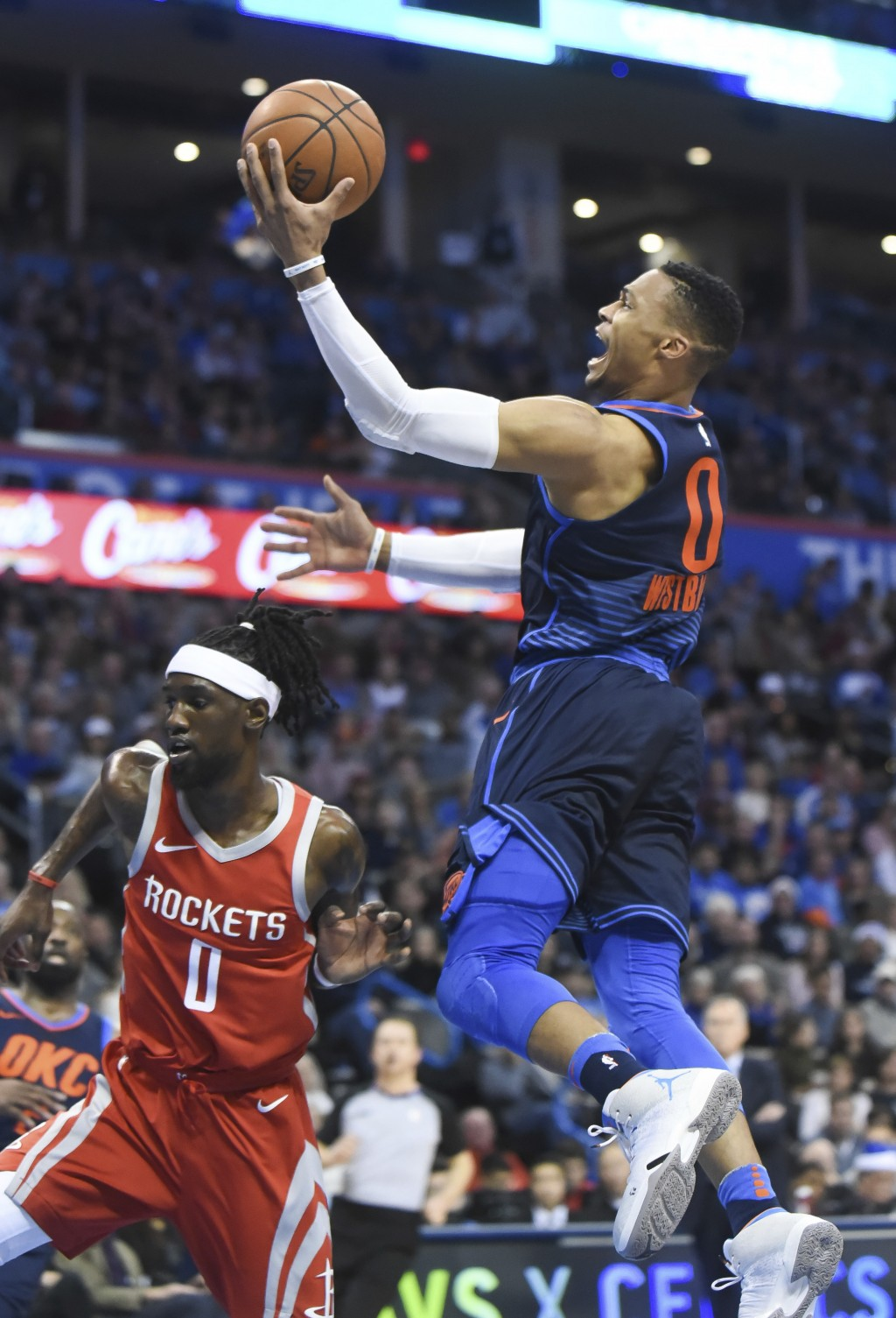 Oklahoma City Thunder's Russell Westbrook goes up for a shot over Houston Rockets' Briante Weber in the second half of an NBA basketball game in Oklah...