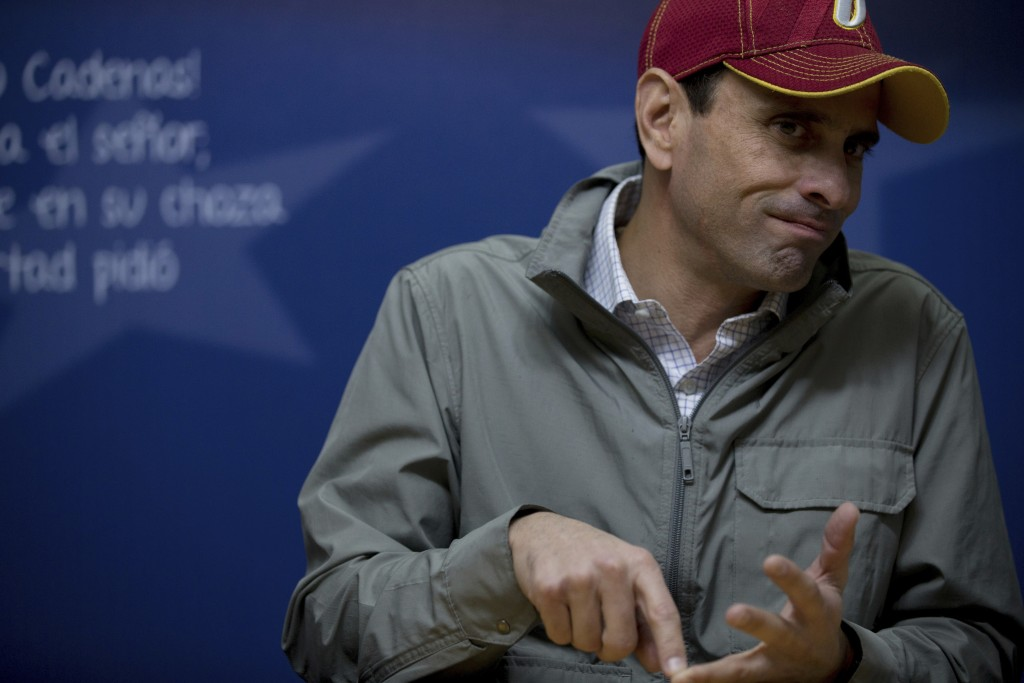 In this Dec. 12, 2017 photo, opposition leader Henrique Capriles gives an interview at his office in Caracas, Venezuela. Capriles defended the opposit...