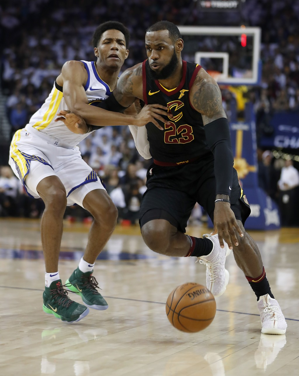 Cleveland Cavaliers forward LeBron James (23) drives to the basket past Golden State Warriors guard Patrick McCaw during the first half of an NBA bask...