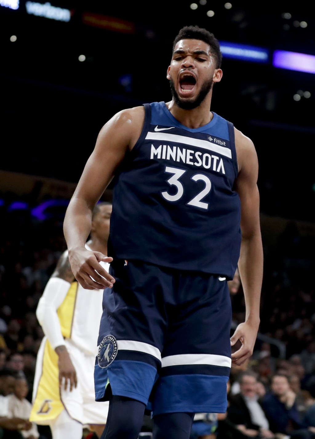 Minnesota Timberwolves center Karl-Anthony Towns celebrates after making a basket against the Los Angeles Lakers during the first half of an NBA baske...