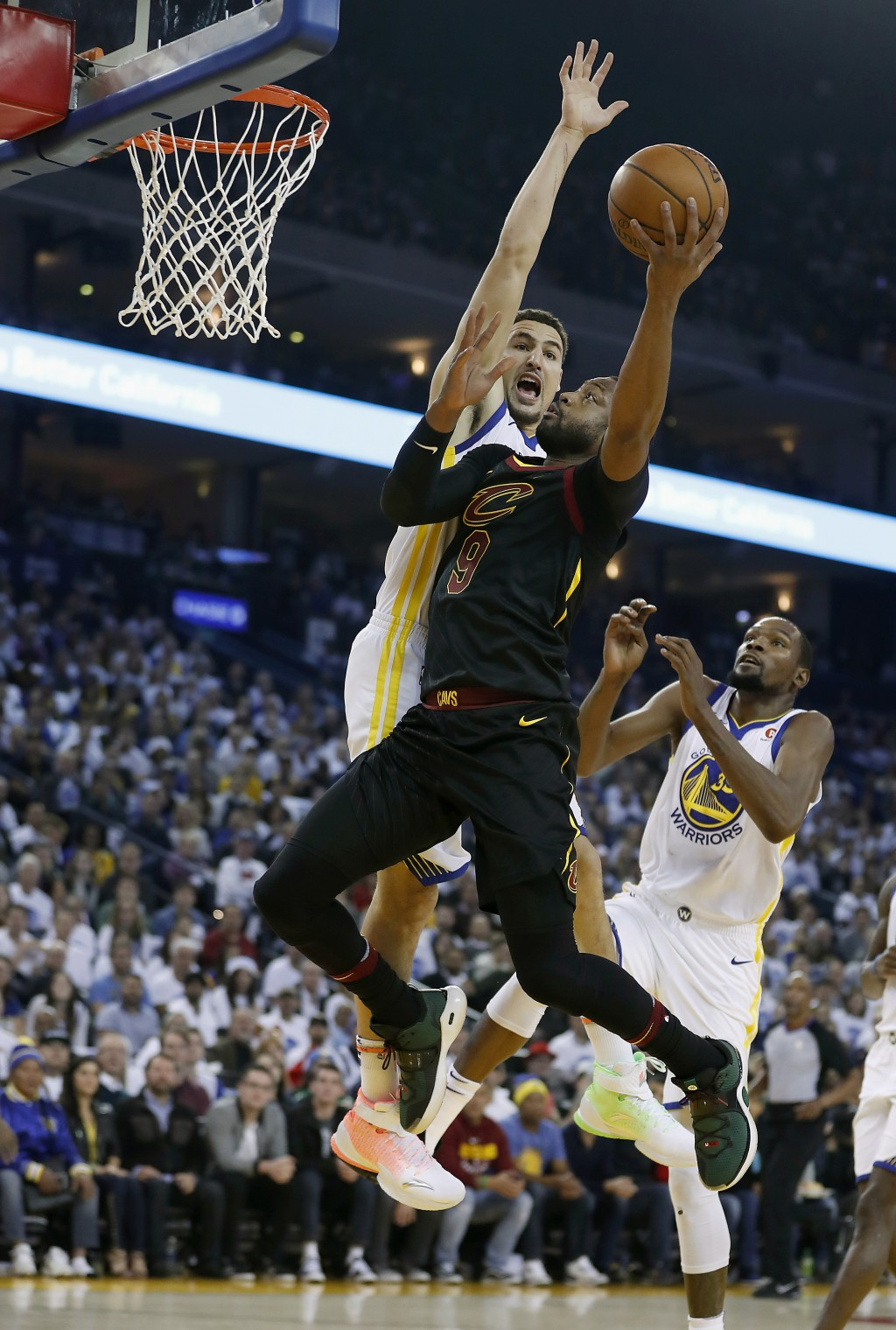Cleveland Cavaliers guard Dwyane Wade (9) drives to the basket against Golden State Warriors guard Klay Thompson (11) during the first half of an NBA ...