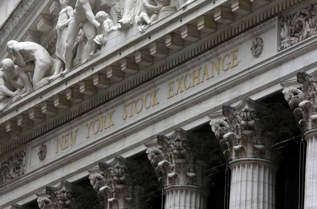 FILE - This Oct. 2, 2014, file photo shows the facade of the New York Stock Exchange. U.S. stocks edged mostly lower in light trading early Tuesday, D...