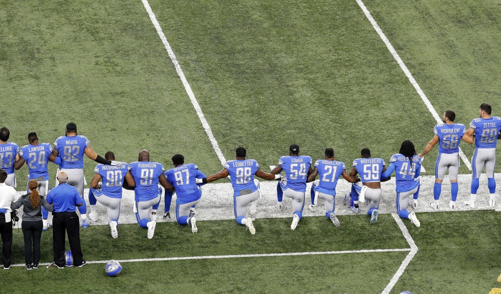 FILE - In this Sept. 24, 2017, file photo, Detroit Lions players take a knee during the national anthem before an NFL football game against the Atlant...