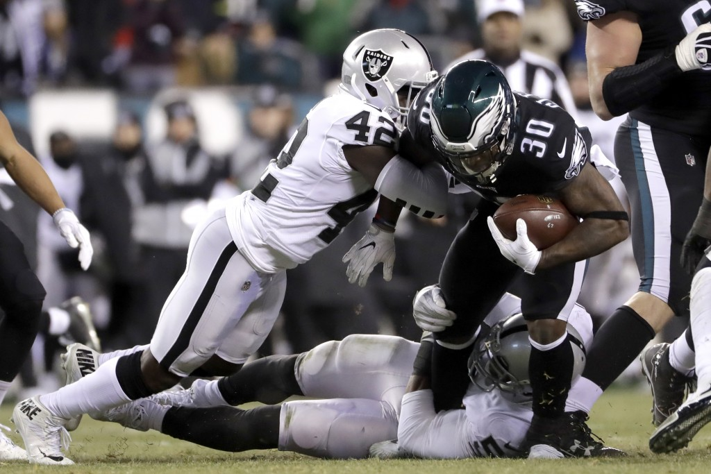 Philadelphia Eagles' Corey Clement (30) rushes against Oakland Raiders' Karl Joseph (42) during the first half of an NFL football game, Monday, Dec. 2...