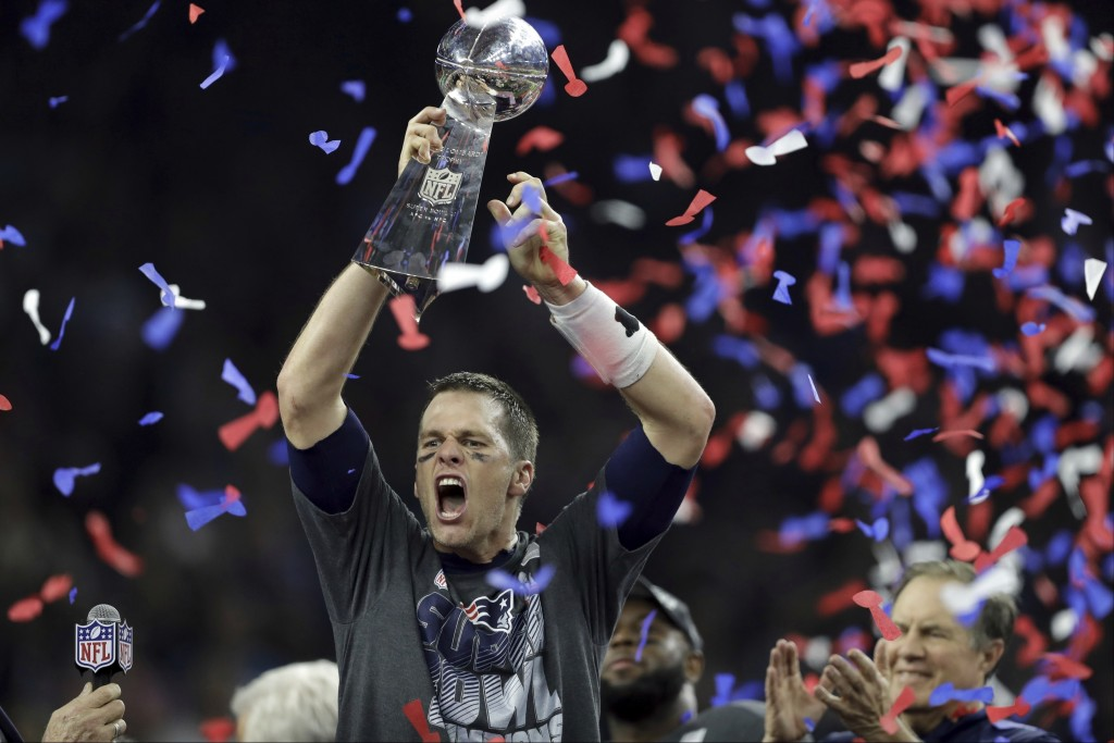 FILE - In this Feb. 5, 2017, file photo, New England Patriots' Tom Brady raises the Vince Lombardi Trophy after defeating the Atlanta Falcons in overt...