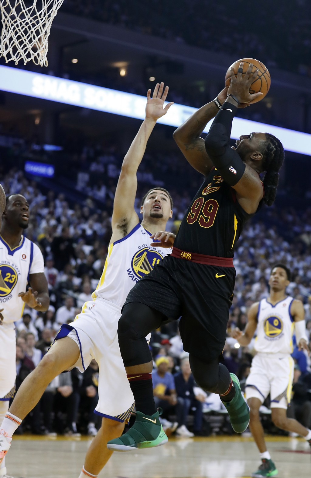 Cleveland Cavaliers forward Jae Crowder (99) shoots over Golden State Warriors guard Klay Thompson (11) during the first half of an NBA basketball gam...