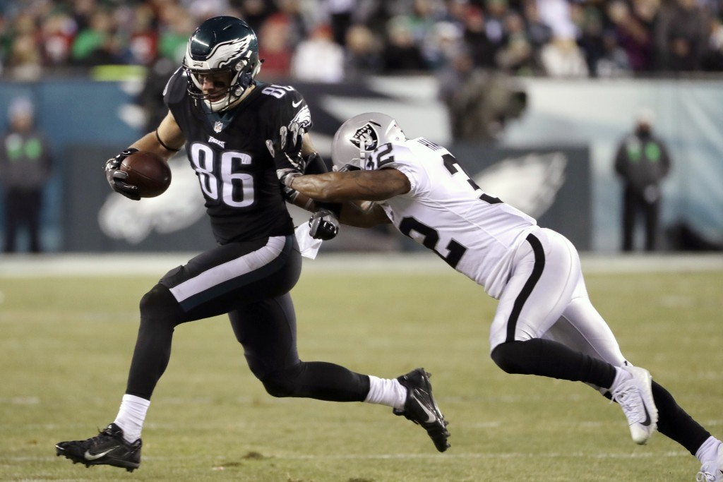 Philadelphia Eagles' Zach Ertz (86) is tackled by Oakland Raiders' Antonio Hamilton (32) during the first half of an NFL football game, Monday, Dec. 2...