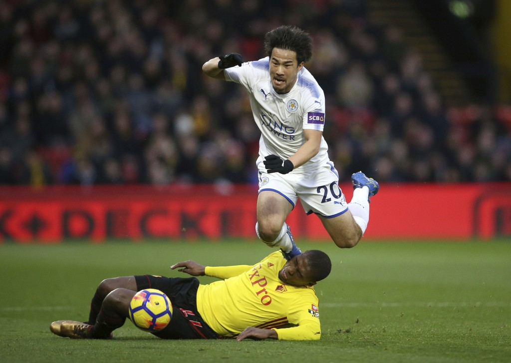 Leicester City's Shinji Okazaki, top, is challenged by Watford's Christian Kabasele during the English Premier League soccer match at Vicarage Road, W...
