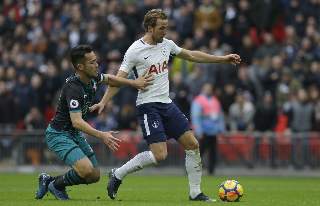 Tottenham Hotspur's Harry Kane goes to shoot and score his sides 5th goal and his third of the game during their English Premier League soccer match b...