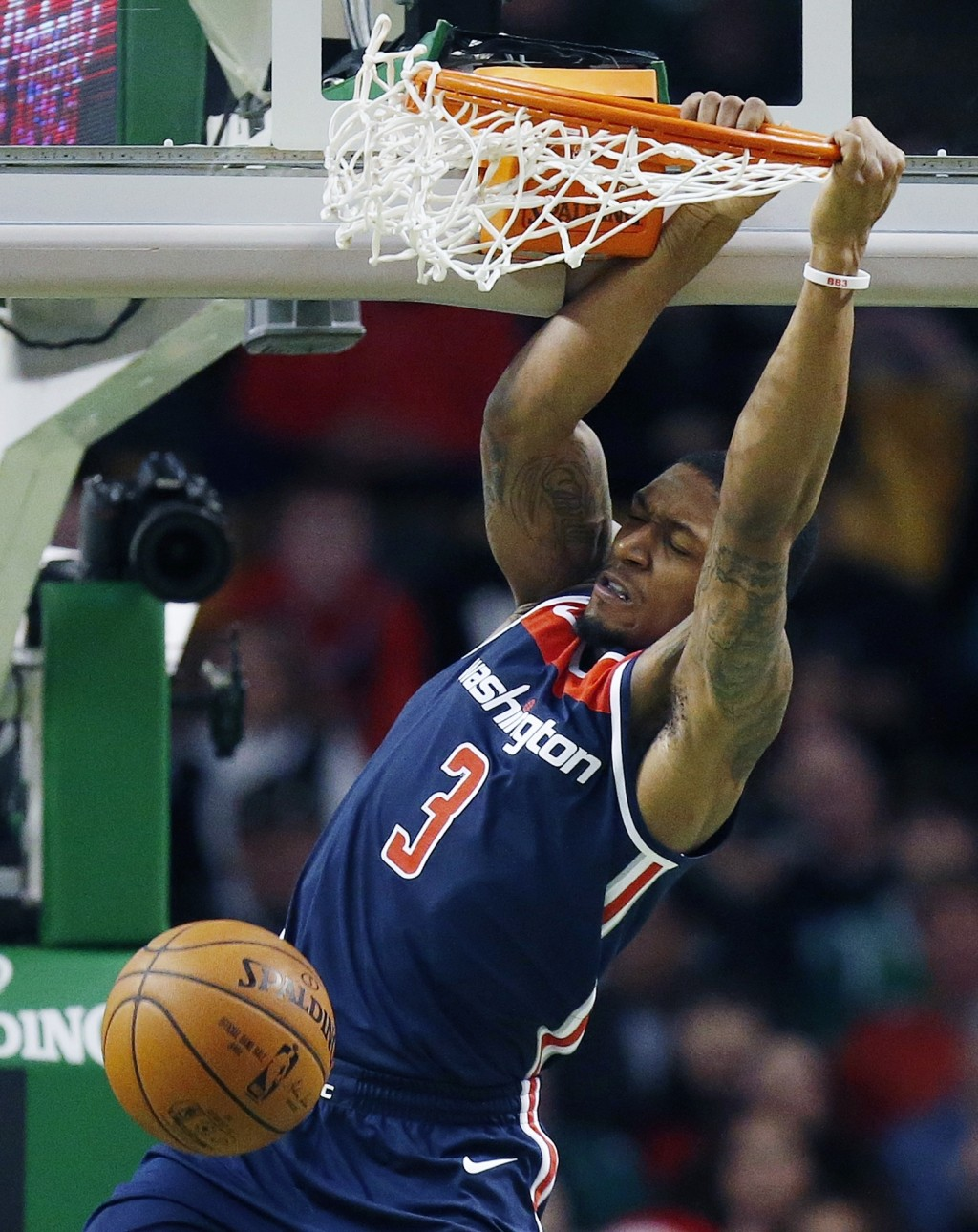 Washington Wizards' Bradley Beal (3) dunks during the second quarter of an NBA basketball game against the Boston Celtics in Boston, Monday, Dec. 25, ...