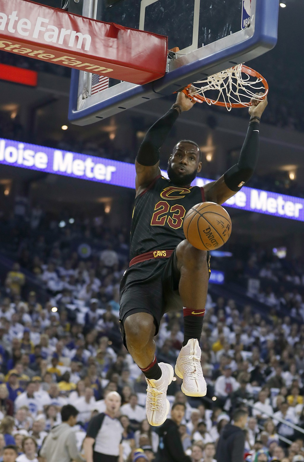 Cleveland Cavaliers forward LeBron James (23) dunks against the Golden State Warriors during the first half of an NBA basketball game in Oakland, Cali...
