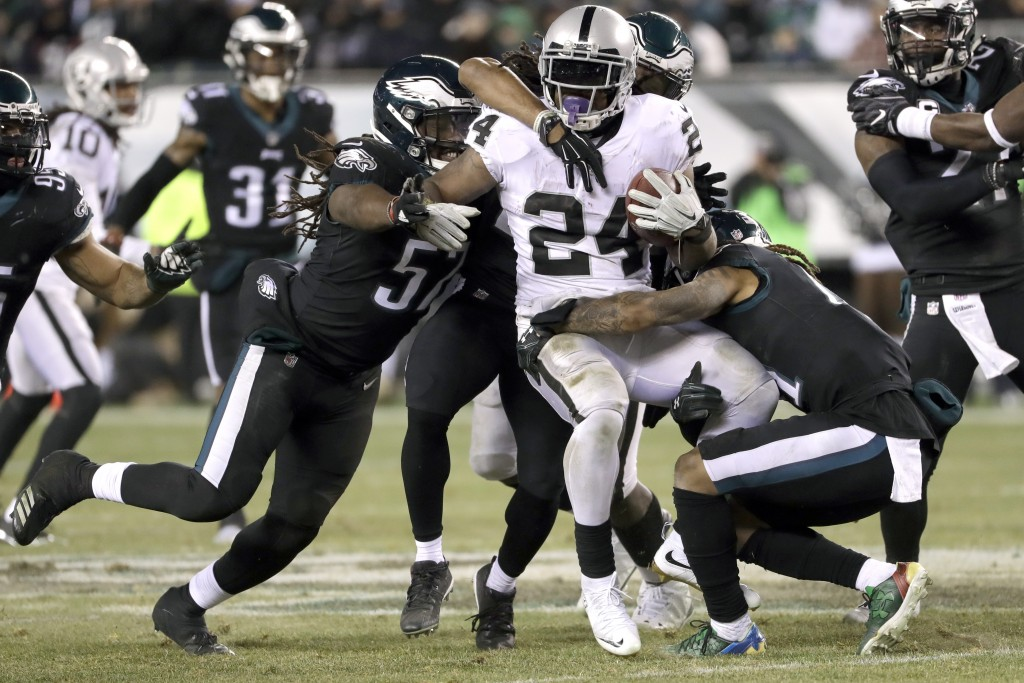 Oakland Raiders' Marshawn Lynch is tackled by the Philadelphia Eagles during the first half of an NFL football game, Monday, Dec. 25, 2017, in Philade...