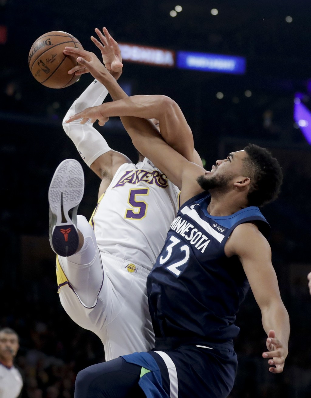 Minnesota Timberwolves center Karl-Anthony Towns, right, battles for a rebound with Los Angeles Lakers guard Josh Hart during the first half of an NBA...