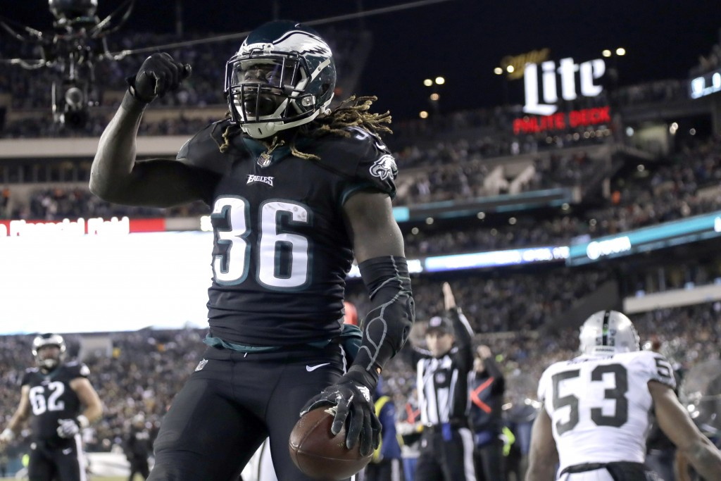Philadelphia Eagles' Jay Ajayi celebrates after scoring touchdown during the first half of an NFL football game against the Oakland Raiders, Monday, D...