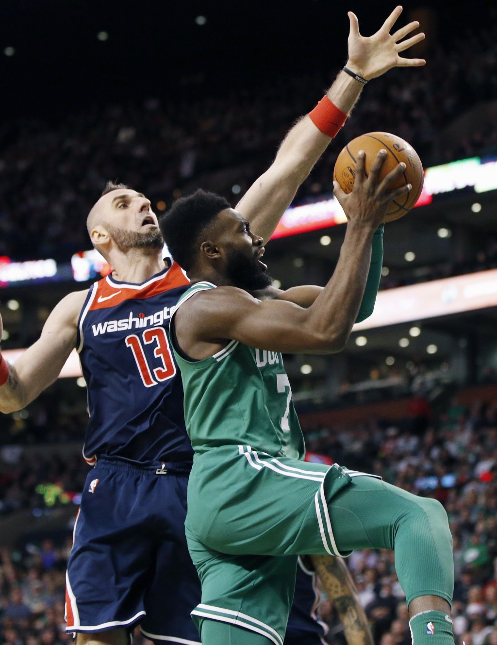 Boston Celtics' Jaylen Brown (7) shoots in front of Washington Wizards' Marcin Gortat (13) during the second quarter of an NBA basketball game in Bost...